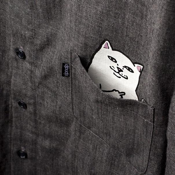Camisetas con bolsillo y gato incorporado f57dba3993d